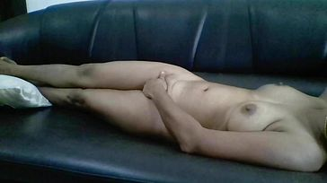 Indian woman jerking on a couch