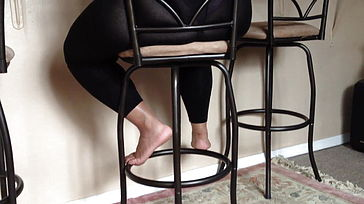 Wife in watch through stretch pants sitting on a bar chair